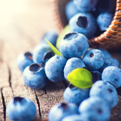 42872708 - blueberry on wooden background. ripe and juicy fresh picked blueberries closeup